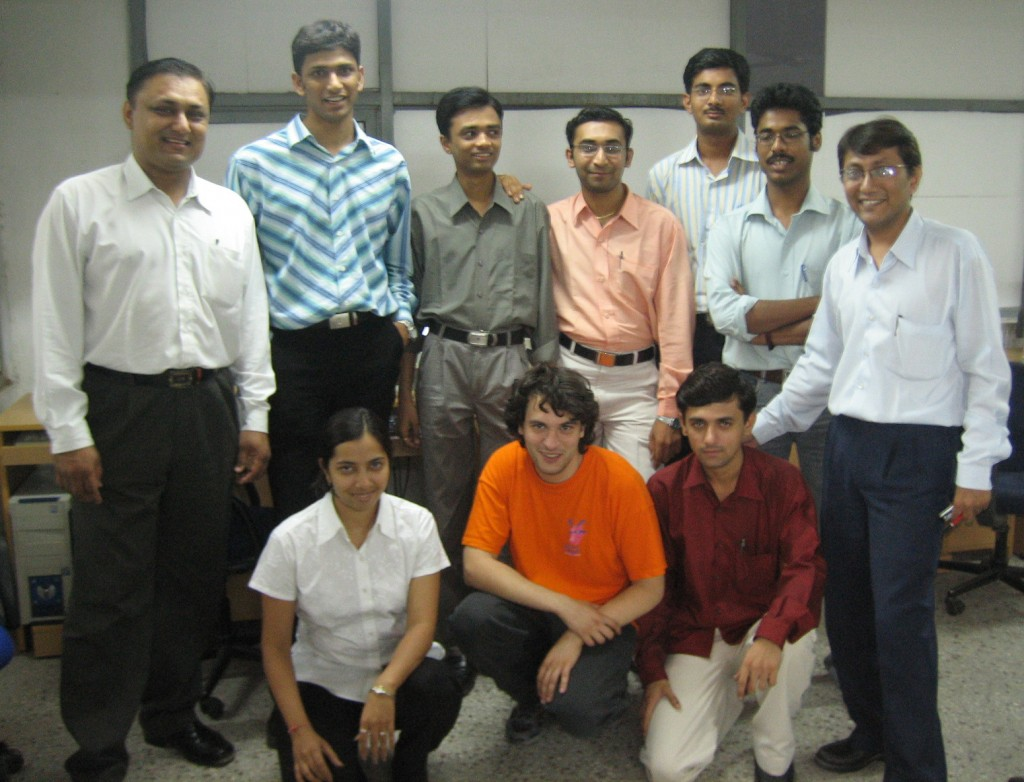 ITER IT specialist Carlo Capuano (below, middle), with members of the Indian IT team. Click picture for high-res.