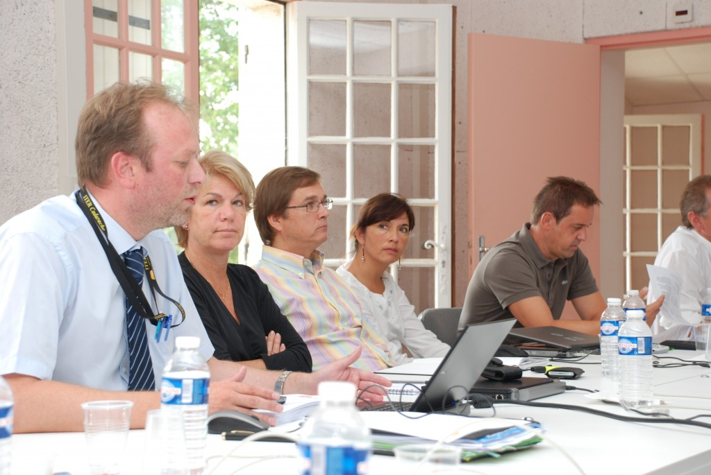 Francoise Flament (second from left) during a recent off-site event where Akko Maas (left) gave a presentation on Export Control issues. (Click to view larger version...)