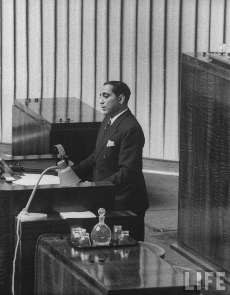 Homi Bhabha at the podium in the UN assembly in Geneva making the opening speech of the First UN Conference on the Peaceful Uses of Atomic Energy.