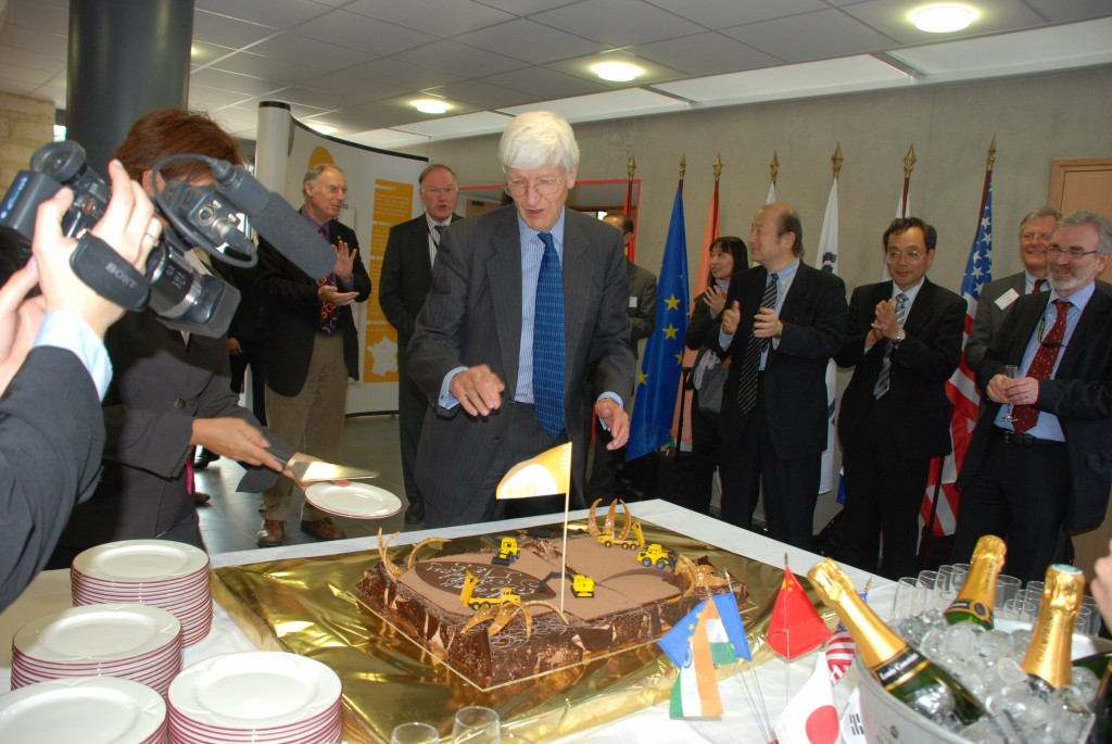 The second day of the Council meeting happened to be the birthday of Chairman Sir Chris Llewellyn Smith. He had wanted to see diggers and bulldozers on the platform ... and he got them! His birthday cake was in the shape of the ITER platform,  complete with diggers and flagpole. (Click to view larger version...)