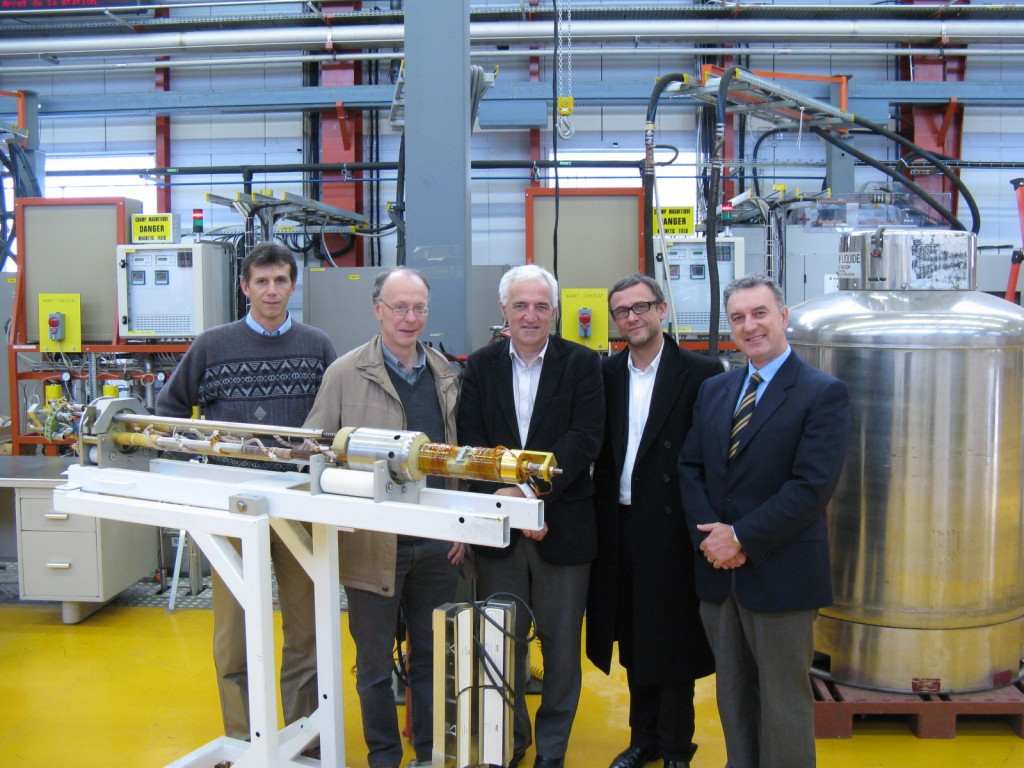 Luca Bottura, Head of the CERN Superconductor and Devices Section; Neil Mitchell, Head of the ITER Magnet Division; Frederick Bordry, Head of the CERN Technology Department; Arnaud Devred, Head of the ITER Superconductor Systems & Auxiliaries Section; and Lucio Rossi, Head of the CERN Magnet, Superconductors and Cryostats Group, standing in front of a sample holder used for critical current measurements of Nb3Sn strands.  (Click to view larger version...)