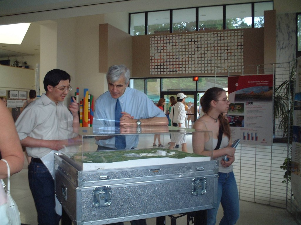 Middle: Nuclear Counselor Jacques Figuet of the French Embassy in Washington, explaining the ITER site model to a visitor. (Click to view larger version...)