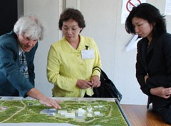 Jean-Michel Bottereau (left, Agence Iter France) explains the ITER site layout to Ms. Kusumi (middle) and Ms. Ishikawa (right). (Click to view larger version...)