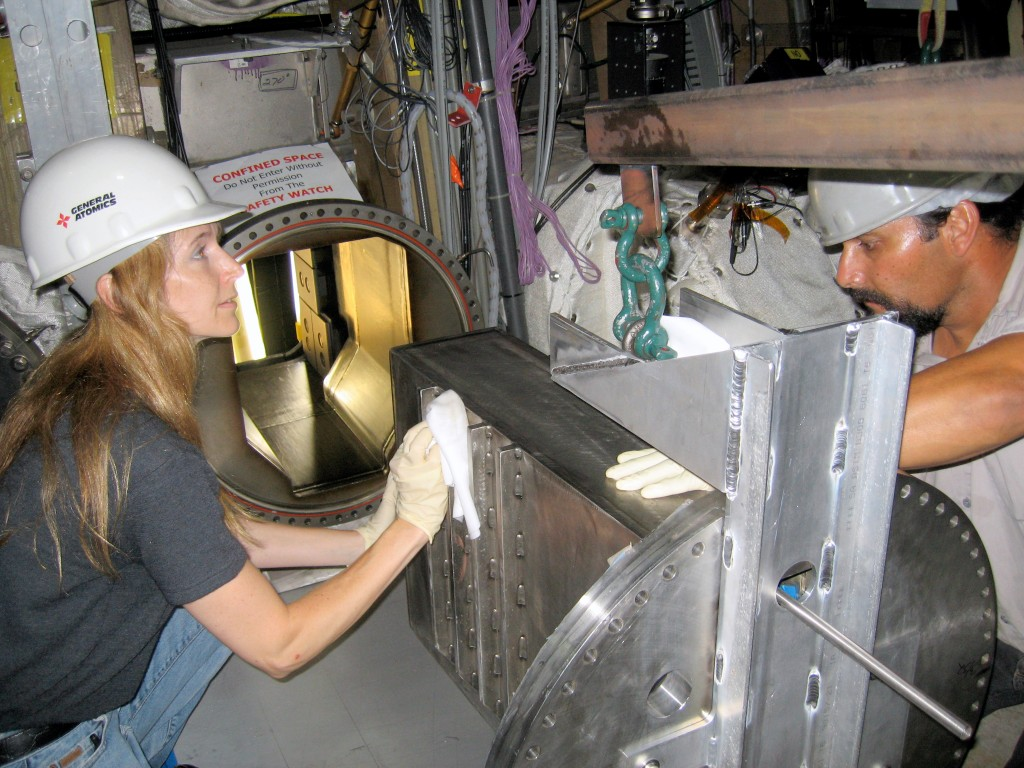 Installation of the TBM mock-up enclosure into a DIII-D horizontal port. The enclosure was designed by the DIII-D engineer in the foreground, Amy Bozek. (Click to view larger version...)