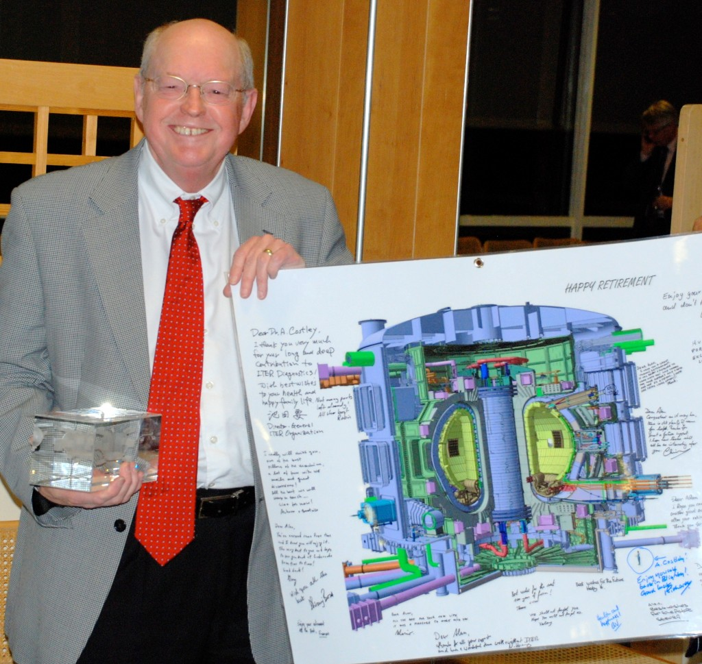 A signed poster of the ITER Tokamak and a ten-kilo paperweight containing a miniature ITER — diagnostic systems included! — will accompany Alan on the next round of his adventures. (Click to view larger version...)
