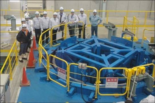 Delegations from the ITER Organization, led by Head of the Magnet Division Neil Mitchell, and the Korean Domestic Agency, represented by Director Kijung Jung, are accompanied by K. Hamada and T. Isono, the Responsible Officers from the Japanese DA, and NSE staff members. All are pictured inspecting the 4-m-diameter spooling equipment. (Click to view larger version...)