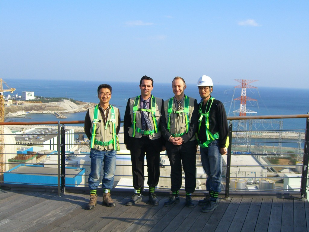 In Shin-Gori, Joël Hourtoule, Ingo Kuehn and Korean colleagues pose in front of the soon-completed nuclear plant. (Click to view larger version...)