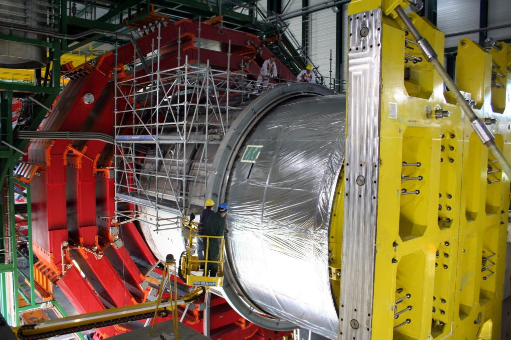 The insertion of the compact muon solenoid into the cryostat.  (Click to view larger version...)