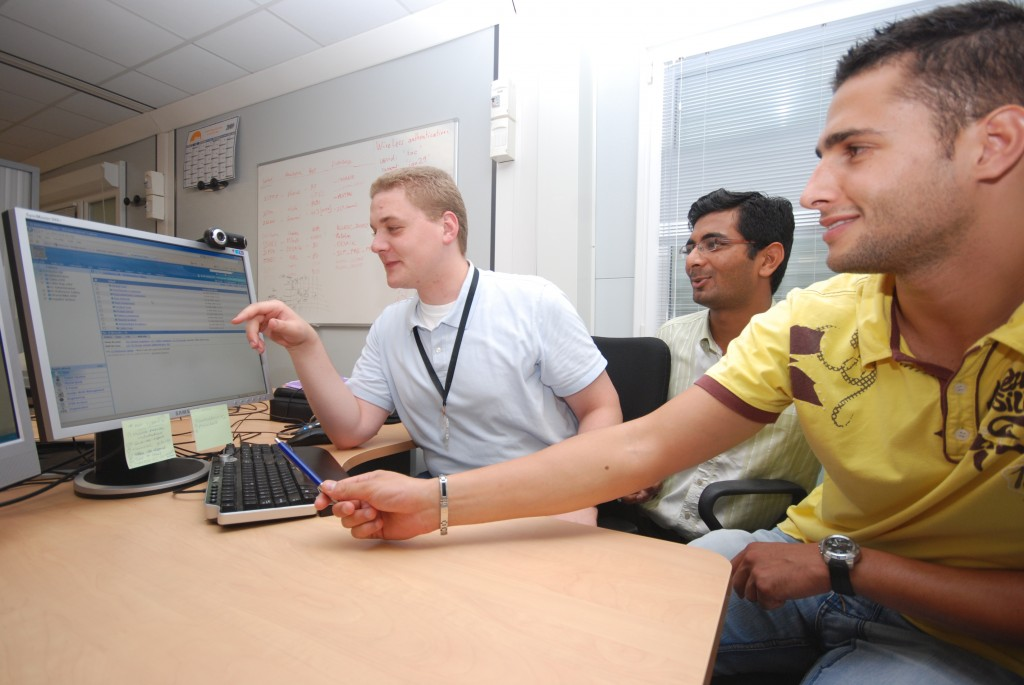 Matt Jewell (ITER-Monaco Fellow), Saumil Modi (ITER ICP Team, SilverTouch, India), and Gregory Bevillard (magnet database developer) in front of the Conductor Database.