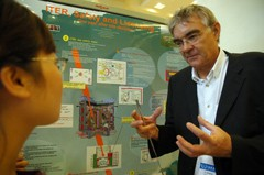 The group leader of the Safety, Environment and Health group, Jean Philippe Girard, explaining ITER safety systems to a participant of the IAEA conference. (Click to view larger version...)