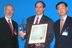 Winner of the inaugural Nuclear Fusion Award, Dr Timothy C. Luce (General Atomics), is presented with his award by Professor Werner Burkart (Deputy Director General, International Atomic Energy Agency) and Dr Mitsuru Kikuchi (Chairman of the Board of Editors, Nuclear Fusion and Director Division of Advanced Plasma Research, Japan Atomic Energy Agency) at the 21st IAEA fusion conference.