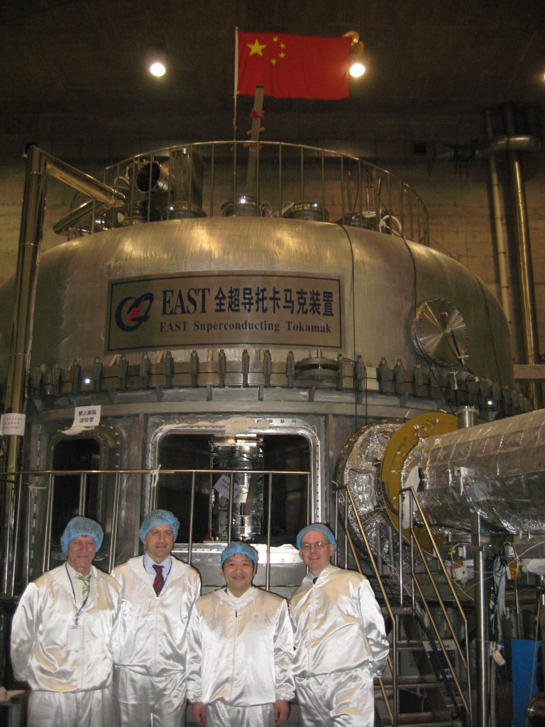 Members of the ITER Vacuum and Cryogenics Groups in front of EAST: Christian Mayaux, Luigi Serio and Robert Pearce next to Yuntao Song, Head of the EAST Design Division.
