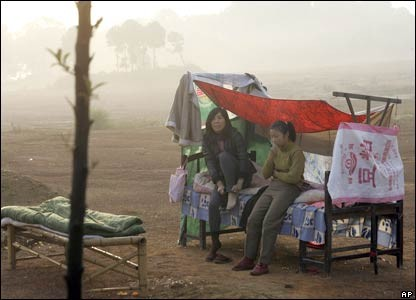 Hundreds of thousands in central China are sleeping outdoors for fear of more tremors after Saturday's earthquake. Photo: BBC  (Click to view larger version...)