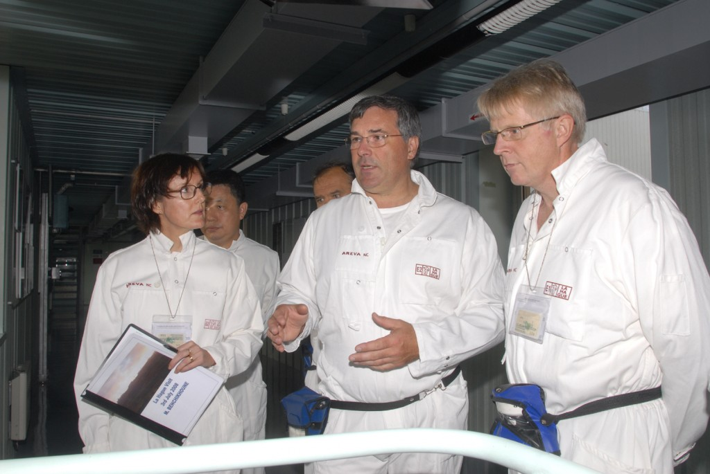 ITER PDDG, Norbert Holtkamp (right), carefully listening to the explanations given by Thierry Flament from AREVA Company. (Click to view larger version...)