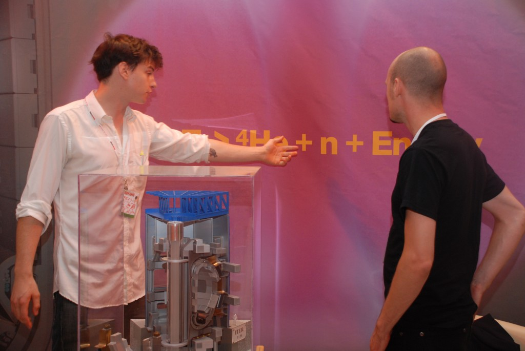 Christopher White (left), ITER Communications, explaining the fusion reaction (Click to view larger version...)
