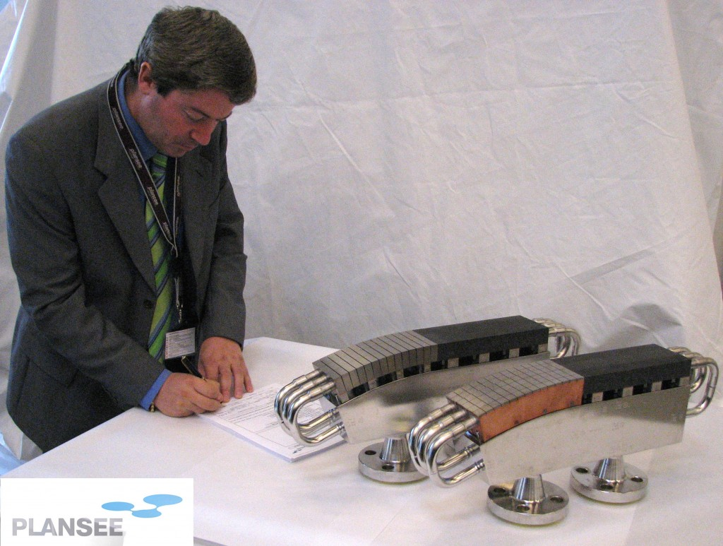Mario Merola in Reutte, Austria, signing the final acceptance of the two EU qualification prototypes manufactured by Plansee. (Click to view larger version...)