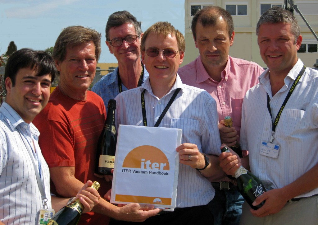 Pumping it up... the ITER Vacuum Group poses with the new handbook
