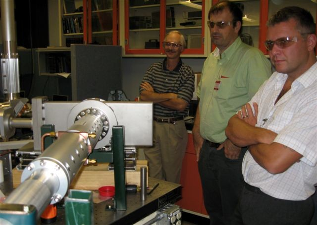 Vacuum Group members examining an ITER prototype ECRH vacuum transmission line at Oak Ridge National Laboratory. (Click to view larger version...)