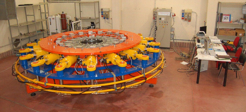 Mockup rings have been stressed to rupture in a testing machine which presents 18 hydraulic independent pulling holders providing a stress distribution in the rings similar to the one the 18 toroidal field coils will induce during operation. (Click to view larger version...)