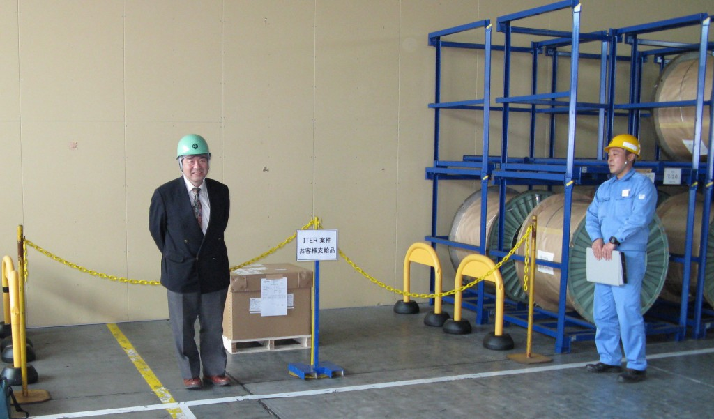 The first small step: the box contains two spools of Nb3Sn strand representing a value of around $30,000. The Japanese Domestic Agency Responsible Technical Officer, Y. Takahashi, stands in front. (Click to view larger version...)