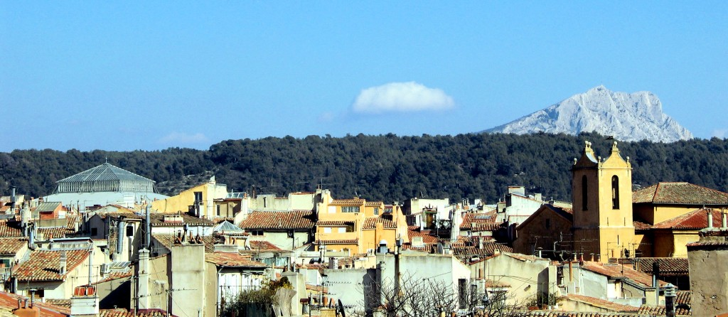 Mount Sainte-Victoire, which rises 1,011 metres from the plain, seems to tower above the town of Aix-en-Provence. (Click to view larger version...)