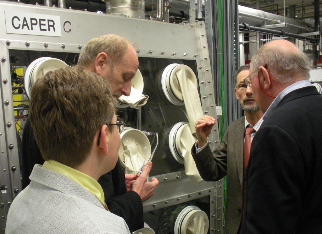 Lothar Dörr (centre), Head of the Tritium Lab, explains the tritium fuel cycle and the principle of the glove boxes to Neil Calder, Head of ITER Communication Office (right). Beate Bornschein, Deputy Head of TLK, and Manfred Glugla, ITER Tritium Plant Division Leader listen in. The CAPER experiment comprises a torus mockup section to produce the tritiated gases resulting from the operation of ITER. (Click to view larger version...)