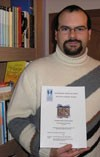 Nuno Bràs Henriques holding his Master's thesis on ITER. (Click to view larger version...)