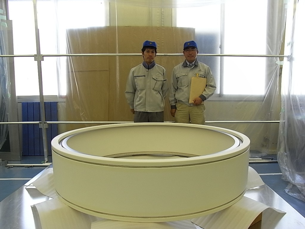 Takashi Inoue (Japan Atomic Energy Agency, JAEA) and Masanobu Tanaka (ITER) proudly present a prototype of the ceramic bushing ring for the ITER neutral beam heating system. (Click to view larger version...)