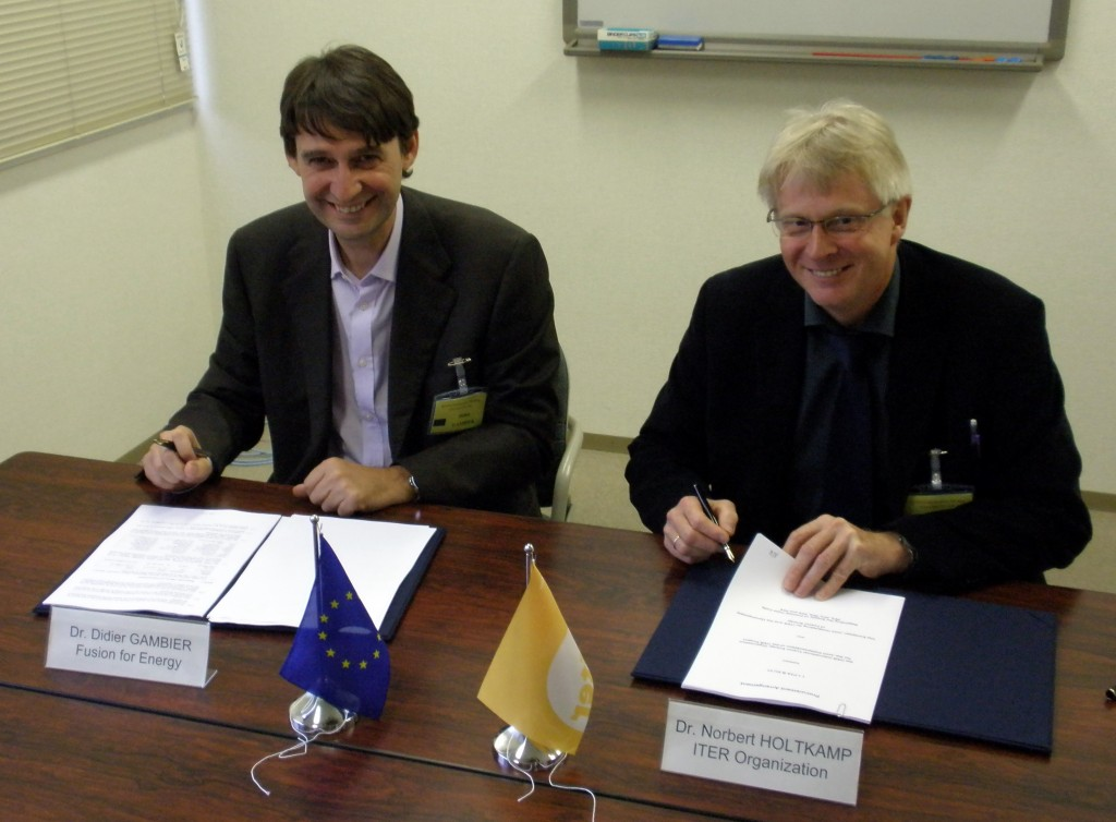 Didier Gambier and Norbert Holtkamp signing the procurement for five out of the six PF Coils for ITER. (Click to view larger version...)