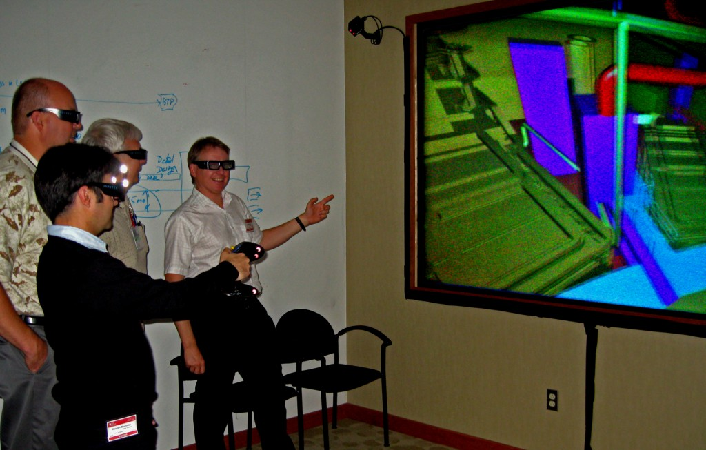 ITER Vacuum Group members Robert Pearce (right) and Bastien Boussier (front) with their US colleagues Walter Gardner and Rodger Moon taking a virtual walk through ITER's piping system. 