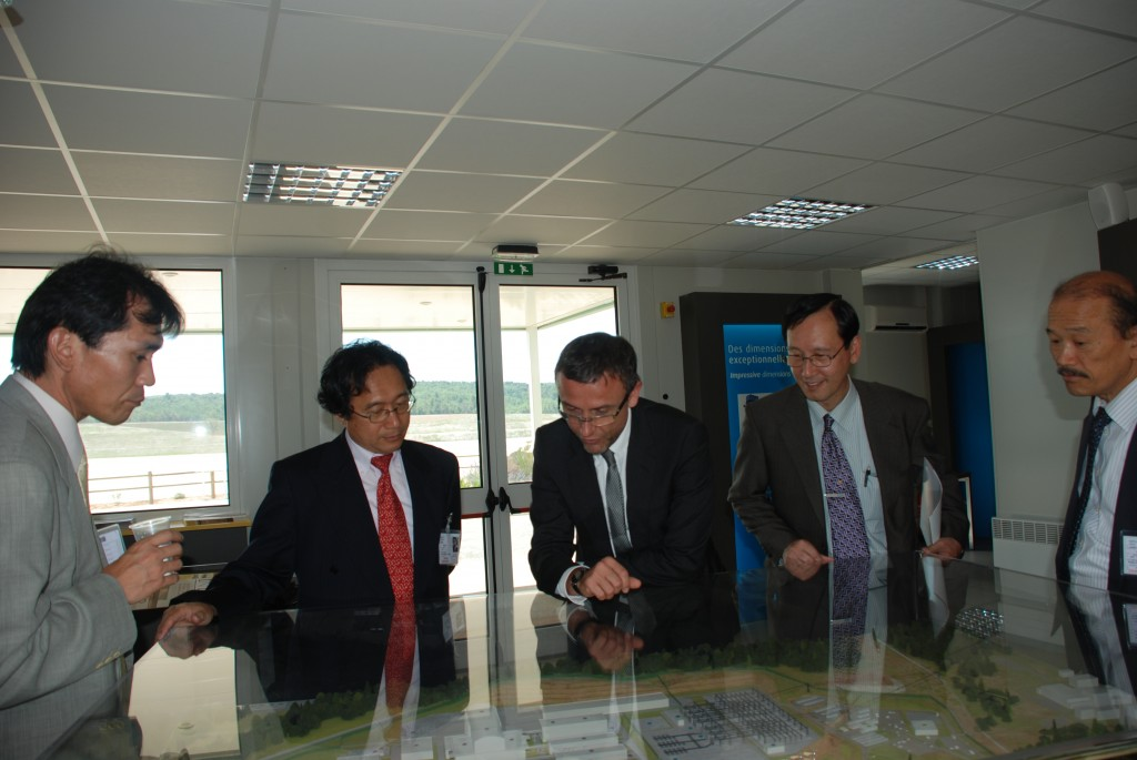 Arnaud Devred, ITER Superconductor Section Leader, explains the site layout to his guests (from left to right): Yukinobu Murakami (Technology Manager), Yasunao Yokota (General Sales Manager and cello player), Arnaud Devred (ITER), .Yoshiro Nishimoto (President), and Akio Kifuji (Sales Manager). (Click to view larger version...)