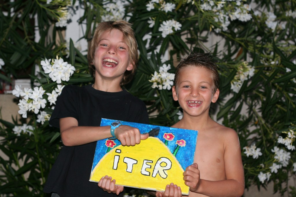 Arthur (left) with his brother Tom showing their interpretation of the ITER logo.