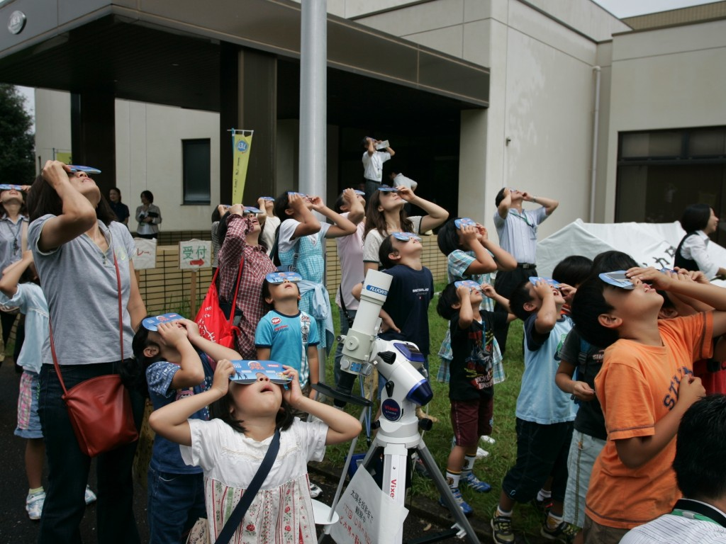 A big event for the small: spectators watching the solar eclipse at Naka.