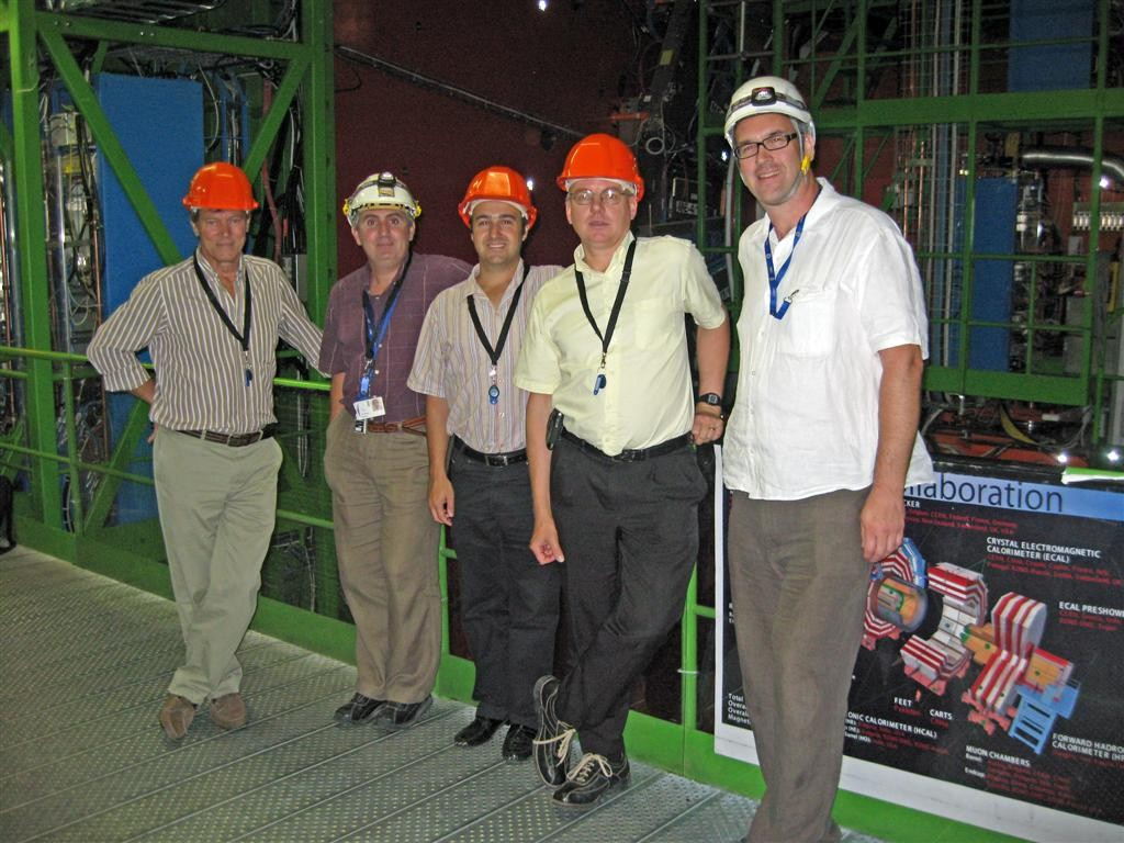Inside the longest vacuum around: Christian Mayaux (ITER), Jose-Miguel Jimenez (CERN) CERN Vacuum Group Leader, Bastien Boussier (ITER), Robert Pearce (ITER) and Raymond Veness (CERN) in the CMS detector Experimental Gallery. (Click to view larger version...)